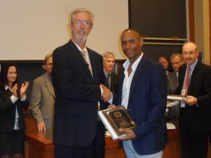 Barton Morris receives plaque at Harvard Law School, July 2013